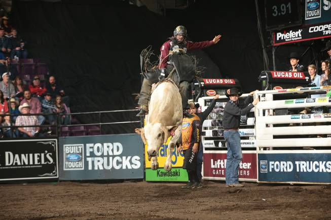 Markus Mariluch rides Frontier Rodeo Company's Good Time Charlie for 76.5 during the first round of the Colorado Springs Built Ford Tough series PBR. Photo by Andy Watson