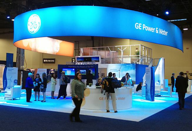 Participants in 2014 Windpower Convention at the Mandalay Bay Convention Center explore the General Electric expo booth on Thurs. May 8, 2014. This is the first time the American Wind Energy Association, an industry trade group with 1,200 members, has held its annual conference in Las Vegas.
