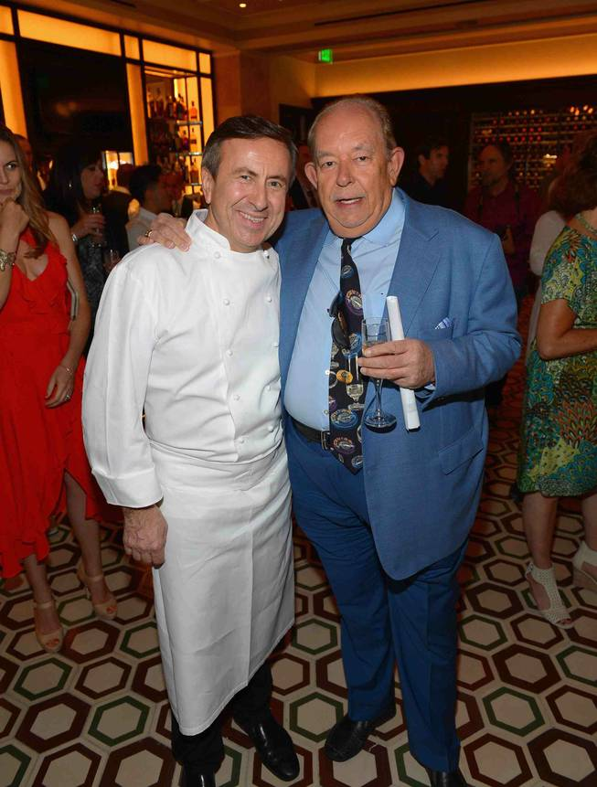 Daniel Boulud and Robin Leach attend the grand opening of DB Brasserie by chef Boulud on Thursday, May 8, 2014, at the Venetian.
