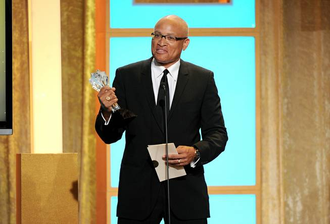 "Larry Wilmore accepts the best talk show award for ""The Daily Show With Jon Stewart"" at the Critics' Choice Television Awards in the Beverly Hilton Hotel on Monday, June 10, 2013, in Beverly Hills, Calif."