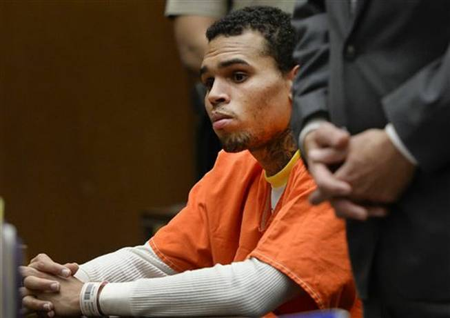 R&B singer Chris Brown appeared Friday in Los Angeles Superior Court and admitted he violated his probation, and was sentenced to serve an additional 131 days in jail. He is shown here in court on Thursday, May 1, 2014. The probation issues were related to the singer's 2009 assault case filed after his attack on then-girlfriend Rihanna.
