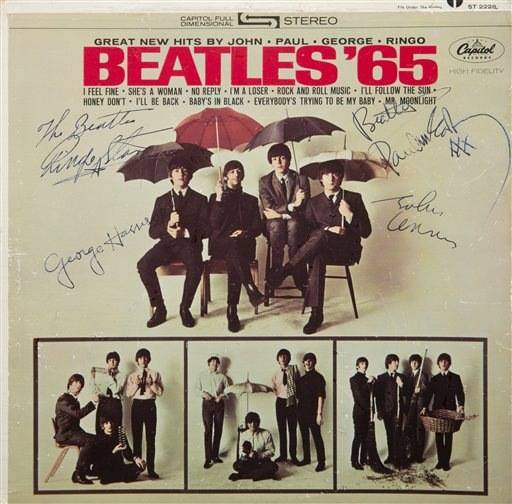 "This undated photo provided by Julien's Auctions shows a ""Beatles '65"" album signed by all four members of the band. It could bring up to $300,000 on May 17, 2014 during a rock memorabilia sale by Julien's Auctions at the Hard Rock Cafe in New York."
