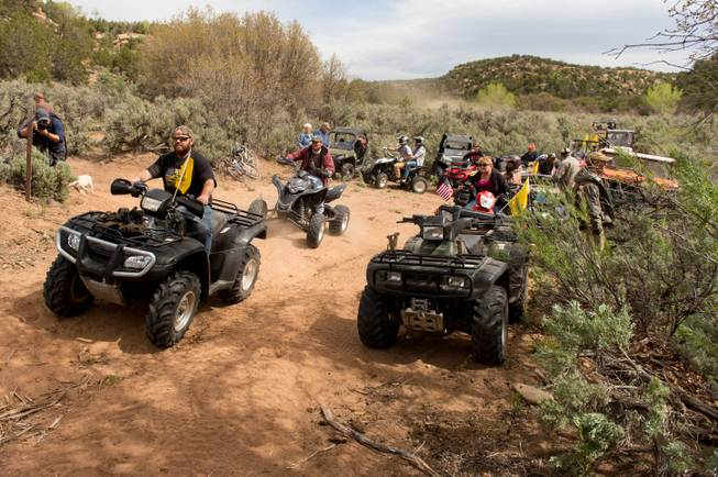 ATV riders cross into a restricted area of Recapture Canyon, north of Blanding, Utah, on Saturday, May 10, 2014, in a protest against what demonstrators call the federal government's overreaching control of public lands. The area has been closed to motorized use since 2007 when an illegal trail was found that cuts through Ancestral Puebloan ruins. The canyon is open to hikers and horseback riders.