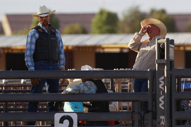 A cowboy laughs during the chute dogging competition during the Bighorn Rodeo Saturday, May 10, 2014. The Bighorn Rodeo is an annual event put on by the Nevada Gay Rodeo Association.