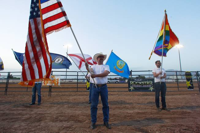 Men hold flags during the Grand Entry at the Bighorn Rodeo Saturday, May 10, 2014. The Bighorn Rodeo is an annual event put on by the Nevada Gay Rodeo Association.