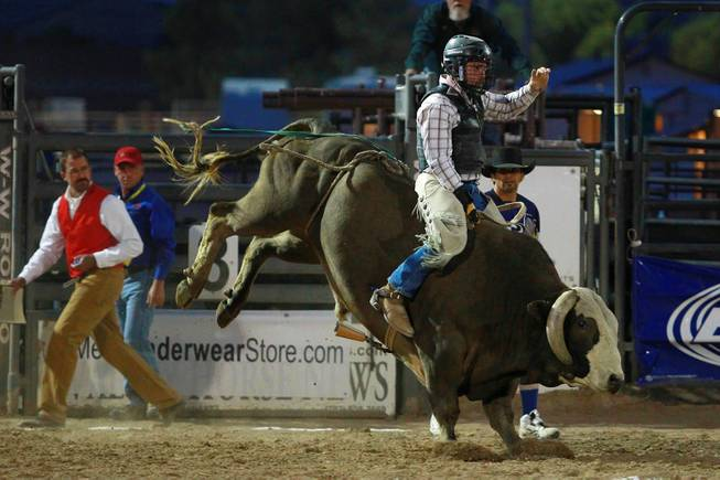 Jason Strand competes in bull riding during the Bighorn Rodeo Saturday, May 10, 2014. The Bighorn Rodeo is an annual event put on by the Nevada Gay Rodeo Association.