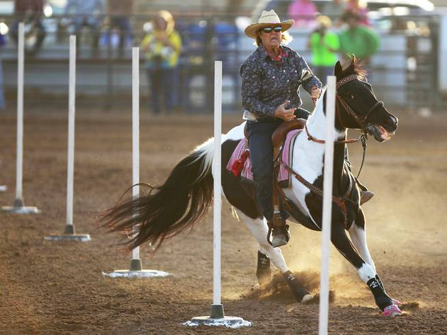 Karen Beavers competes in pole bending during the Bighorn Rodeo Saturday, May 10, 2014. The Bighorn Rodeo is an annual event put on by the Nevada Gay Rodeo Association.