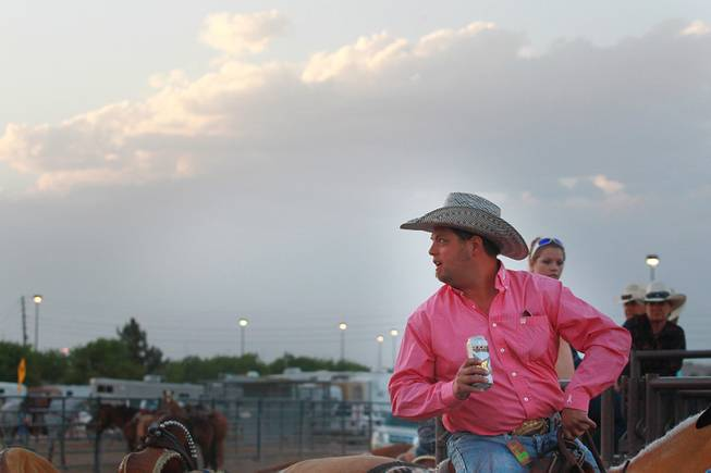 Jason Taylor looks over his shoulder during the Bighorn Rodeo Saturday, May 10, 2014. The Bighorn Rodeo is an annual event put on by the Nevada Gay Rodeo Association.