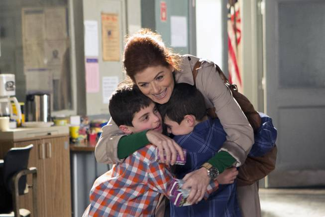 "In this photo provided by NBC, Debra Messing, top, portrays Laura Diamond in the new NBC series, ""The Mysteries of Laura."" Also pictured are Charlie Reina, as Harrison Diamond, left, and Vincent Reina as Nicholas Diamond."