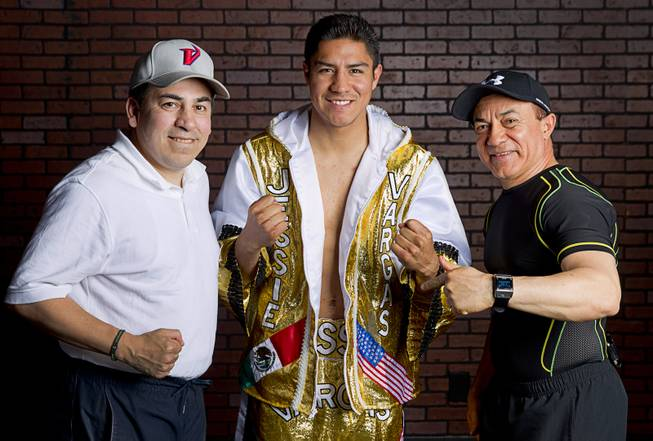 Las Vegan Jessie Vargas poses with assistant trainer Richie Sandoval and trainer Ismael Salas of Cuba before a workout at Top Rank Gym Monday, May 12, 2014. Vargas defeated Khabib Allakhverdiev of Russia at the MGM Grand Garden Arena on April 12 to take the WBA super lightweight (140 lbs.) title. Allakhverdiev was previously undefeated.