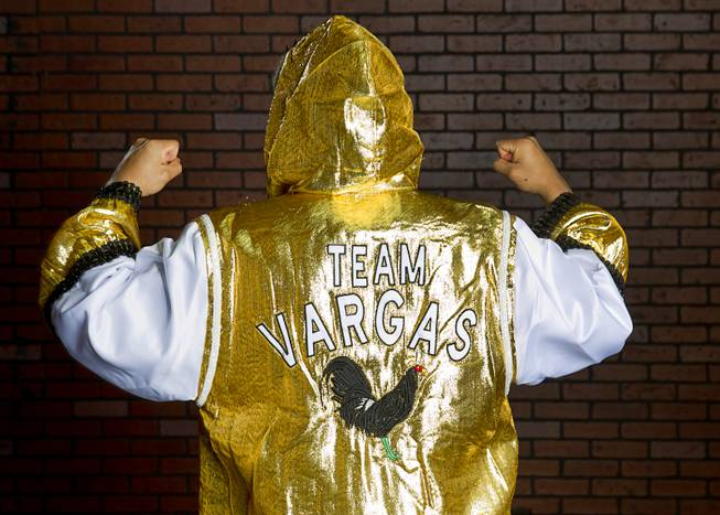 Las Vegan Jessie Vargas show the back of his robe before a workout at Top Rank Gym Monday, May 12, 2014. Vargas defeated Khabib Allakhverdiev of Russia at the MGM Grand Garden Arena on April 12 to take the WBA super lightweight (140 lbs.) title. Allakhverdiev was previously undefeated.