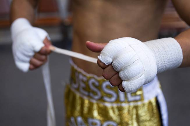 Las Vegan Jessie Vargas wraps his hands before a workout at Top Rank Gym Monday, May 12, 2014. Vargas defeated Khabib Allakhverdiev of Russia at the MGM Grand Garden Arena on April 12 to take the WBA super lightweight (140 lbs.) title. Allakhverdiev was previously undefeated.