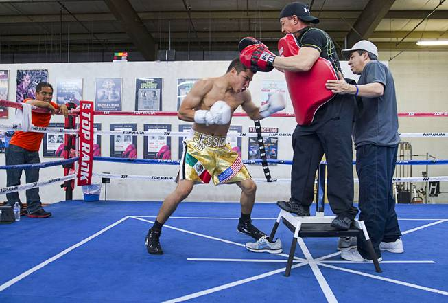 Las Vegan Jessie Vargas works on his timing with trainer Ismael Salas at Top Rank Gym Monday, May 12, 2014. Vargas defeated Khabib Allakhverdiev of Russia at the MGM Grand Garden Arena on April 12 to take the WBA super lightweight (140 lbs.) title. Allakhverdiev was previously undefeated.