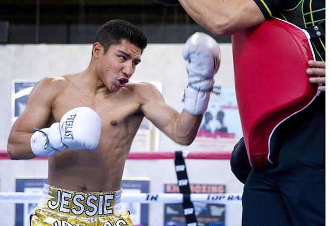 Las Vegas boxer Jessie Vargas works out with trainer Ismael Salas at Top Rank Gym on Monday, May 12, 2014.