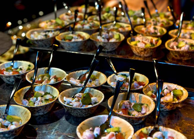 The Grand Tasting during the Uncork'd annual event features many tasty dishes at Caesars Garden of the Gods Pool on Friday, May 9, 2014.