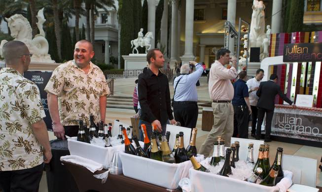 Plenty of wine is ready to be served at the Grand Tasting during the Uncork'd annual event at Caesars Garden of the Gods Pool on Friday, May 9, 2014.