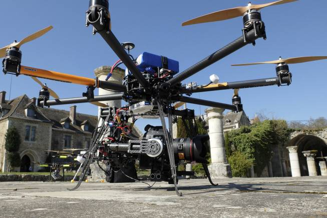 A drone is displayed at the Abbaye Des-Vaux-de-Cernay southwest of Paris, Thursday March 20, 2014. Fornier operated the remote controlled drone used to used to transmit live video of snowboard and ski jump competitions at the Sochi Olympic Games.