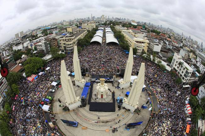 In this photo released by Siam 360 and taken from a drone, anti-government protesters stage a rally, calling for Thai Prime Minister Yingluck Shinawatra to step down, at Democracy Monument in Bangkok, Thailand, Sunday, Nov. 24, 2013.