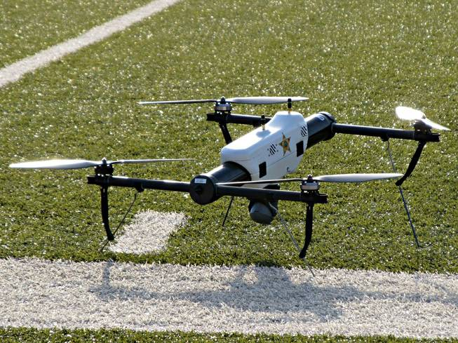 In this May 14, 2013 file photo, one of several small drones designed for use by law enforcement and first responders is shown at University of North Dakota in Grand Forks, N.D.