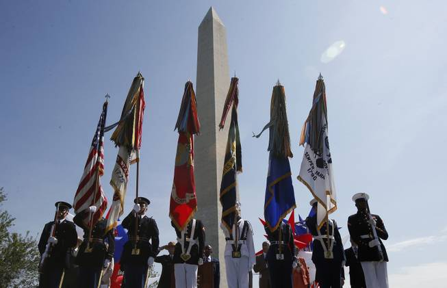 The Armed Forces Color Guard presents the colors at the Washington Monument in Washington, Monday, May 12, 2014, during a ceremony to celebrate its re-opening. The monument, which sustained damage from an earthquake in August 2011, reopened to the public today.