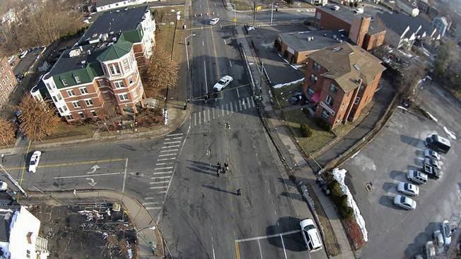 This Feb. 1, 2014 photo, taken by a camera mounted on a drone aircraft and provided by Pedro Rivera, shows an auto that crashed into a building in Hartford, Conn. Rivera filed a federal lawsuit Tuesday, Feb. 18, 2014, alleging that Hartford police officers violated his  rights by demanding he stop using the aircraft to record images of the wreck.