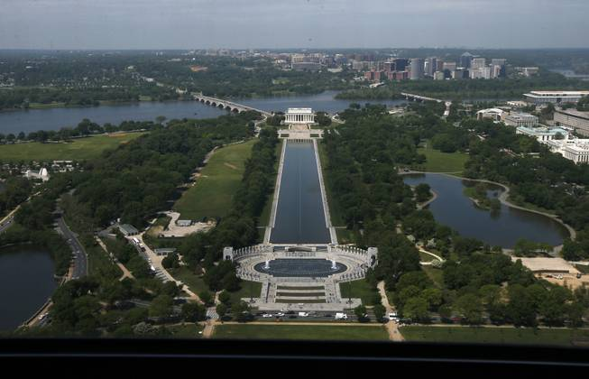 The Lincoln Memorial, rear, and the National World War II Memorial are seen from the 500-foot level of the Washington Monument in Washington, Monday, May 12, 2014, after a ceremony celebrated its re-opening. The monument, which sustained damage from an earthquake in August 2011, reopened to the public today.