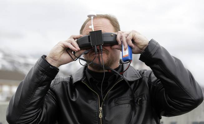In this Feb. 13, 2014, photo, Deputy Larry Blanchard with the Box Elder County Sheriffs Office search and rescue team, is shown wearing a head set for viewing the video feed from the search and rescue drone during a demonstration Thursday, in Brigham City, Utah.
