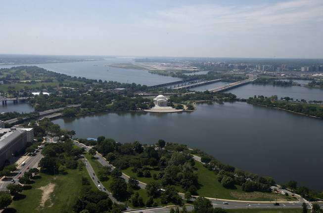 The Jefferson Memorial and Tidal Basin are seen from the 500-foot level of the Washington Monument in Washington, Monday, May 12, 2014, as it reopens. The monument, which sustained damage from an earthquake in August 2011, reopened to the public today.