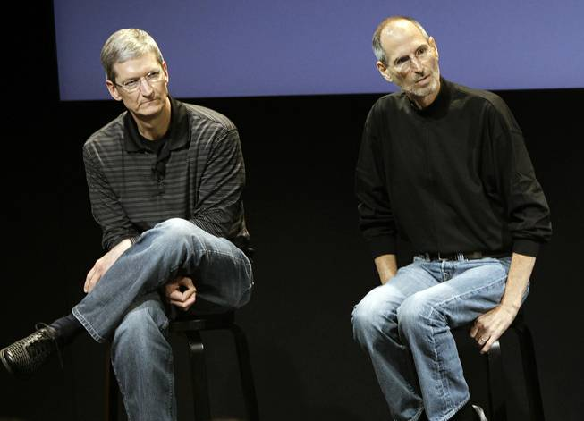 This July 16, 2010 photo shows Apple's Tim Cook, left, and Steve Jobs, right, during a meeting at Apple in Cupertino, Calif.