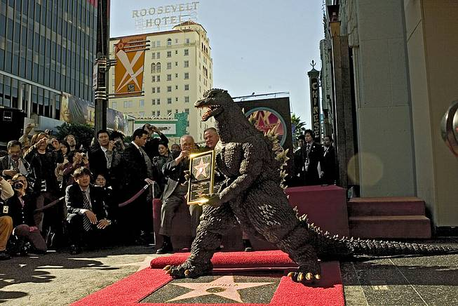 In this Nov. 29, 2004, file photo, the Godzilla character celebrates its 50th anniversary with a star on the Hollywood Walk of Fame next to Grauman's Chinese Theater, now TCL Chinese Theater, along Hollywood Boulevard in Los Angeles.