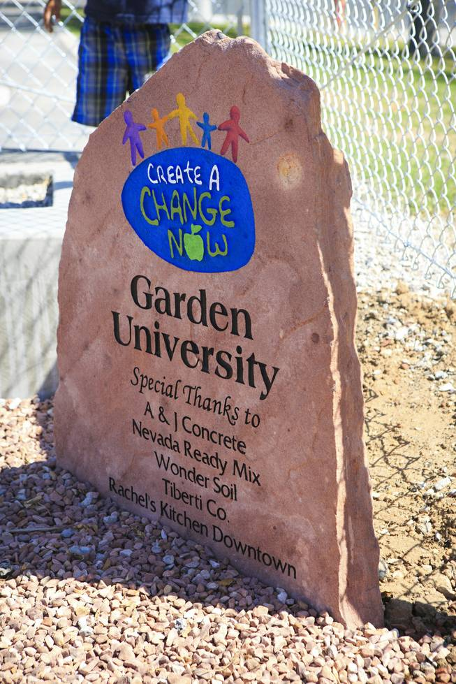 A Create A Change Now plaque is seen at the Garden Club at Lunt Elementary during the unveiling of the school's edible garden, Garden University on Friday, May 2, 2014.