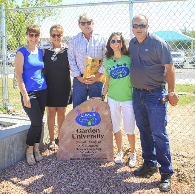 From left: Julie Sanders-Kolter- Volunteer Chair and Nutritionist for Extraordinary Lifestyles Candace Maddin, co-founder and president of Create A Change Now Mike Sherwood- President of Nevada Ready Mix Melissa Blynn, Chief Operating Officer for Create A Change Now.Drew from J.A. Tibertil Co were onsite at Lunt Elementary for the unveiling of the school's edible garden, Garden University on Friday, May 2, 2014.