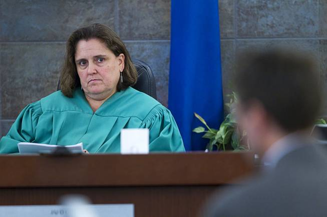 "Judge Kathleen Delaney listens to defense attorney Abel Yanez as he cross examines Louis Colombo, 35, a former housemate of Jason Omar Griffith, during Griffith's trial at the Regional Justice Center Tuesday, May 13, 2014. Colombo testified he helped Griffith dispose of the body of Luxor ""Fantasy"" dancer Deborah Flores Narvaez in 2010."