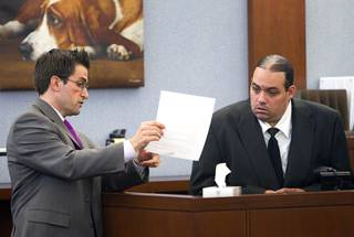 Defense attorney Abel Yanez, left, questions Louis Colombo, 35, a former housemate of Jason Omar Griffith, during Griffith's trial at the Regional Justice Center Tuesday, May 13, 2014. Colombo testified he helped Griffith dispose of the body of Luxor