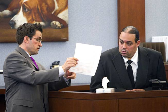 "Defense attorney Abel Yanez, left, questions Louis Colombo, 35, a former housemate of Jason Omar Griffith, during Griffith's trial at the Regional Justice Center Tuesday, May 13, 2014. Colombo testified he helped Griffith dispose of the body of Luxor ""Fantasy"" dancer Deborah Flores Narvaez in 2010."