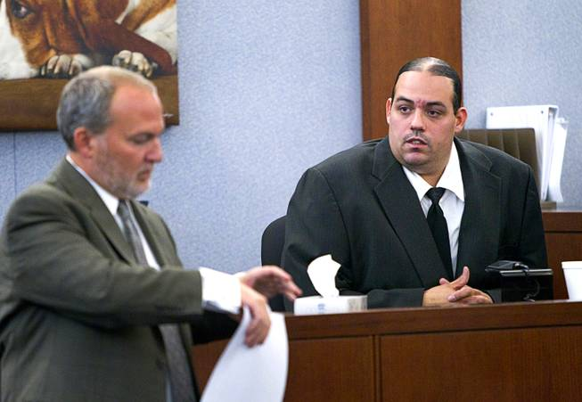"Louis Colombo, right, 35, a former housemate of Jason Omar Griffith, responds to a question from prosecutor Marc DiGiacomo during Griffith's trial at the Regional Justice Center Tuesday, May 13, 2014. Colombo testified he helped Griffith dispose of the body of Luxor ""Fantasy"" dancer Deborah Flores Narvaez in 2010."