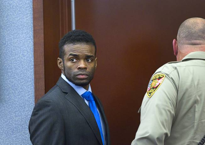 "Jason Omar Griffith, left, leaves the courtroom during a break in his trial at the Regional Justice Center Tuesday, May 13, 2014. Griffith is accused of murdering Luxor ""Fantasy"" dancer Deborah Flores Narvaez in December 2010."