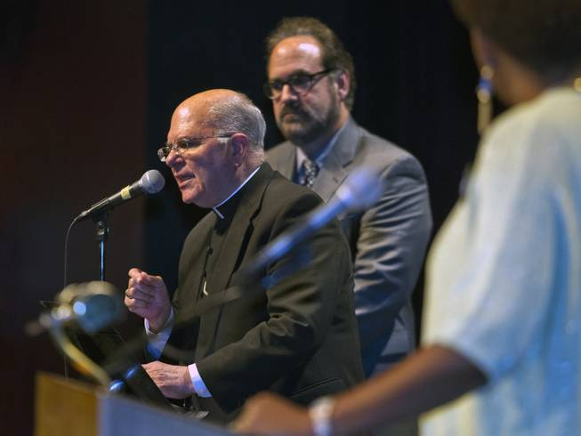 Bishop Joseph Pepe is joined by Rabbi Sanford Akselrad to announce the next steps and call to order during the Nevadans for the Common Good second community convention at the Cashman Center on Tuesday, May 13, 2014. Pepe is with the Roman Catholic Diocese of Las Vegas and Akselrad with Congregation Ner Tamid.