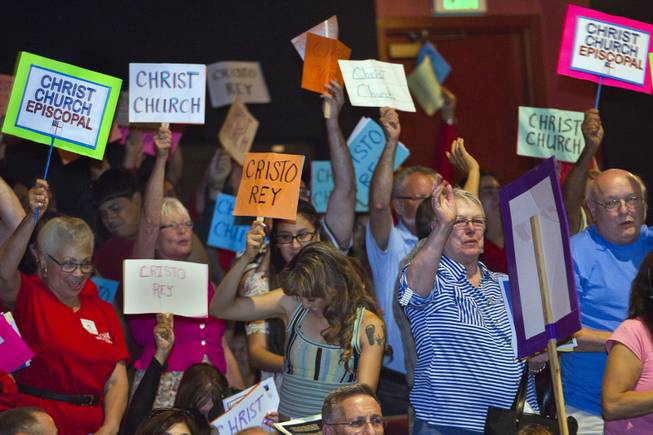 Christ Church Episcopal members cheer as they are introduced during the Nevadans for the Common Good  second community convention gathering at the Cashman Center on Tuesday, May 13, 2014.