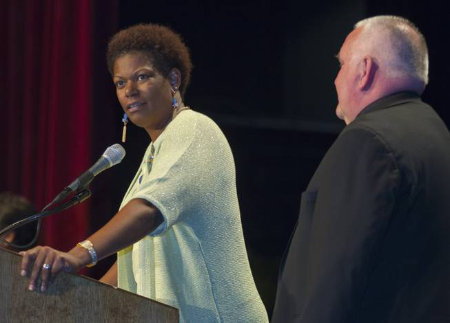Rev. Camille D. Pentsil and Re. Bob Stoeckig call to order the Nevadans for the Common Good second community convention at the Cashman Center on Tuesday, May 13, 2014.  They are event co-chairs, she is with Zion United Methodist Church and he with St. Andrew Catholic Community Church.