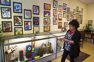 Dee Dee Woodberry, activities and art director, stands by a display of artwork made by seniors at the Nevada Senior Services Adult Day Care Center of Las Vegas, 901 N. Jones Blvd., Wednesday, May 14, 2014. The artwork at the center is mostly made with repurposed materials.