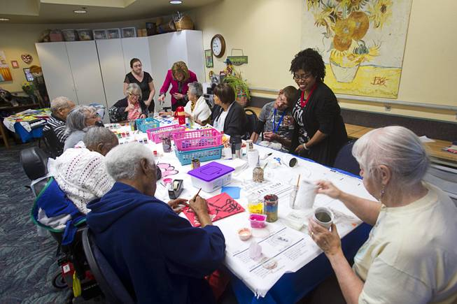 Seniors work on art projects at the Nevada Senior Services Adult Day Care Center of Las Vegas, 901 N. Jones Blvd., Wednesday, May 14, 2014.