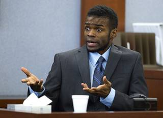 Defendant Jason Omar Griffith speaks to the jury as he testifies in his own defense during his trial at the Regional Justice Center Wednesday, May 14, 2014. Griffith is accused of murdering Luxor