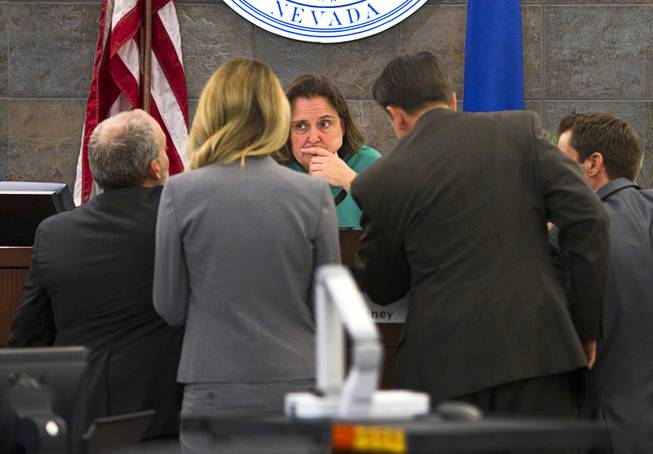 "Judge Kathleen Delaney, center, confers with attorneys during a trial for Jason Omar Griffith at the Regional Justice Center Wednesday, May 14, 2014. Griffith is accused of murdering Luxor ""Fantasy"" dancer Deborah Flores Narvaez in December 2010."