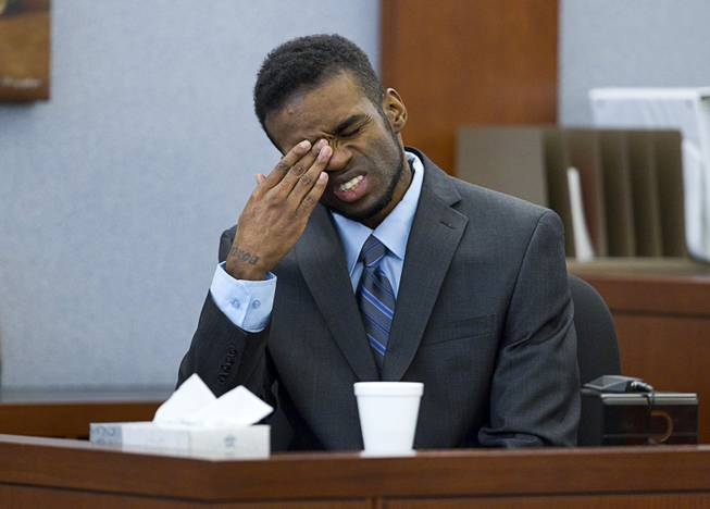 "Defendant Jason Omar Griffith reacts as a 9-1-1 recording is played during his trial at the Regional Justice Center Wednesday, May 14, 2014. Griffith is accused of murdering Luxor ""Fantasy"" dancer Deborah Flores Narvaez in December 2010."