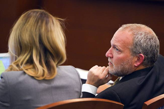 "Prosecutors Marc DiGiacomo, right, and Michelle Fleck confer during a trial for Jason Omar Griffith at the Regional Justice Center Wednesday, May 14, 2014. Griffith is accused of murdering Luxor ""Fantasy"" dancer Deborah Flores Narvaez in December 2010."
