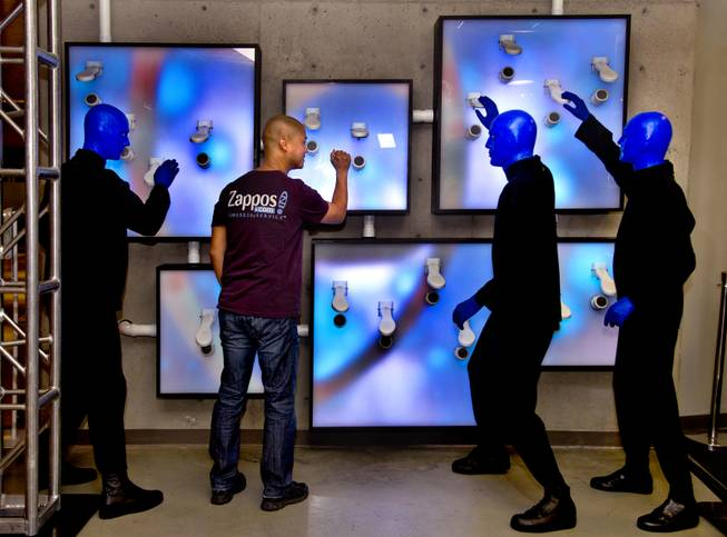 Zappos CEO Tony Hsieh joins the Blue Man Group as they unveil a collaborative, interactive art installation entitled ShoeZaphone during the10th Annual Zappos Bald and Blue charity event on Wednesday, May 15, 2014.