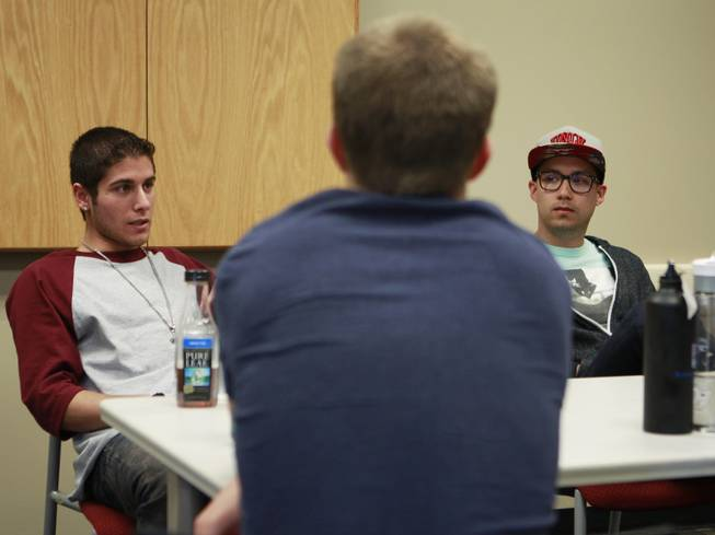 From left, Omid Mahban, Trevor Scheer and Michael Fildes talk during a meeting of the UNLV's NRAP recovery support group Wednesday, April 30, 2014.