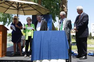 Benefactors Dorothy and Lacy Harber are joined by Associate Executive Director Linda Smith, left, Executive Director Ed Guthrie and foundation president Bob Brown, far right, as they read a statement during an event for Opportunity Village Thursday, May 1, 2014.