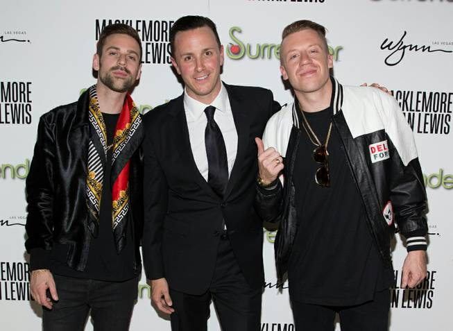 Sean Christie is flanked by Macklemore, right, and Ryan Lewis during Surrender's third-anniversary celebration Thursday, June 6, 2013, at Encore.